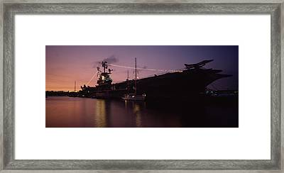 Silhouette Of An Aircraft Carrier Framed Print by Panoramic Images