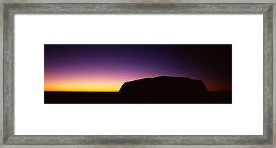 Silhouette Of Ayers Rock Formations Framed Print by Panoramic Images