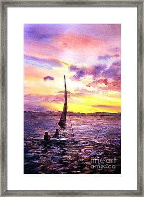 Silhouette Of Boat And Sailors On Torch Lake Michigan Usa Framed Print by Ryan Fox