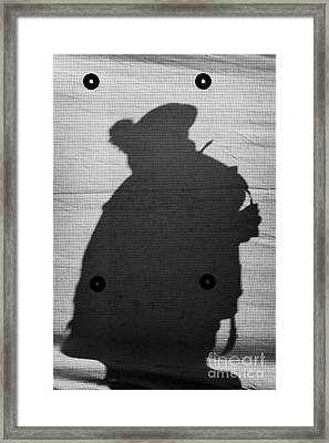 Silhouette Of British Army Soldier On Screen On Crumlin Road At Ardoyne Shops Belfast 12th July Framed Print by Joe Fox