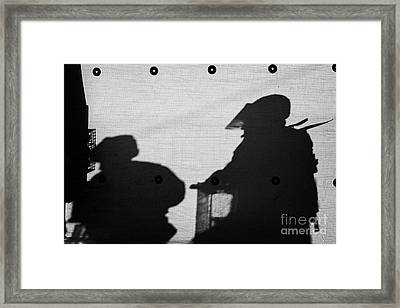 Silhouette Of British Army Soldiers On Screen On Crumlin Road At Ardoyne Shops Belfast 12th July Framed Print by Joe Fox