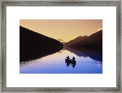 Silhouette Of Canoeists, Bowron Lake Framed Print by Chris Harris