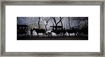 Silhouette Of Horse Drawn Carriages Framed Print
