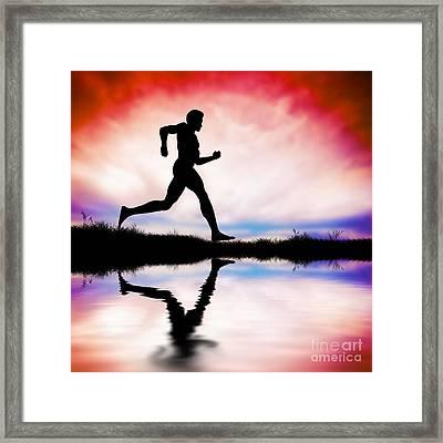 Silhouette Of Man Running At Sunset Framed Print