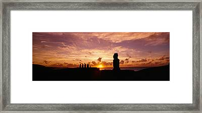 Silhouette Of Moai Statues At Dusk Framed Print