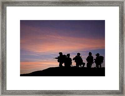 Silhouette Of Modern Troops In Middle East Silhouette Against Be Framed Print