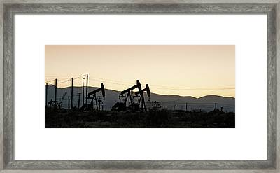 Silhouette Of Oil Rigs At Sunset Framed Print by Panoramic Images