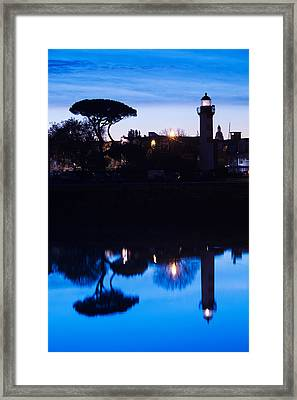 Silhouette Of Old Port Lighthouse Framed Print by Panoramic Images