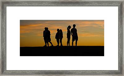 Silhouette Of People On A Hill, Baldwin Framed Print