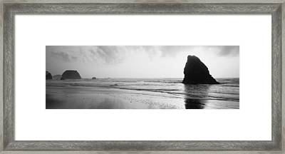 Silhouette Of Rocks On The Beach, Fort Framed Print by Panoramic Images