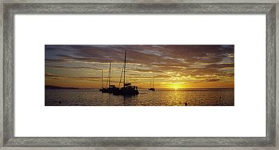 Silhouette Of Sailboats In The Sea Framed Print by Panoramic Images