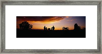 Silhouette Of Statues Of Soldiers Framed Print by Panoramic Images