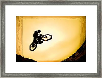 Silhouette Of Stunt Cyclist Framed Print