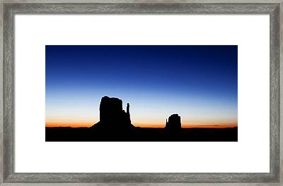 Silhouette Of The Mitten Buttes In Monument Valley  Framed Print by Susan Schmitz