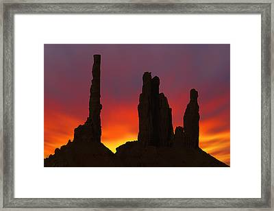Silhouette Of Totem Pole After Sunset - Monument Valley Framed Print