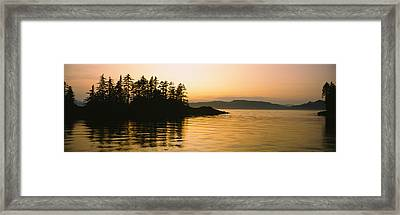 Silhouette Of Trees In An Island Framed Print by Panoramic Images