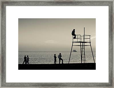 Silhouette People On Pier At Sunset Framed Print