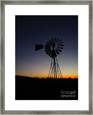 Silhouetted Aermotor Framed Print by Dan Julien