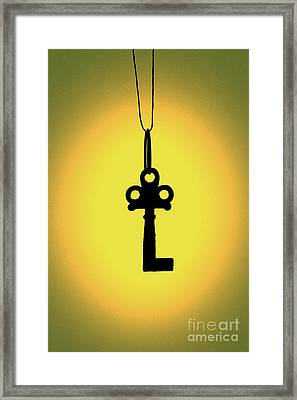 Silhouetted Key Framed Print