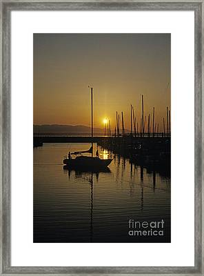 Silhouetted Man On Sailboat Framed Print