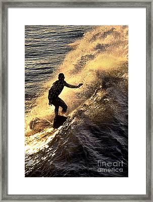 Silhouetted Surfer Framed Print