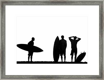 Silhouetted Surfers Framed Print by Sean Davey