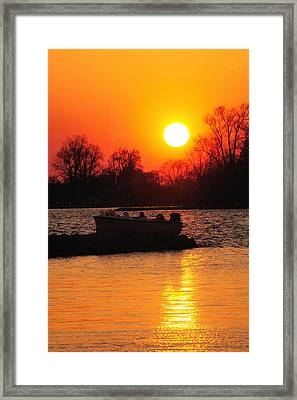 Silhouettes And Fire Framed Print