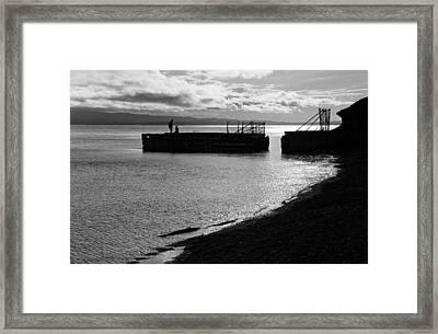 Silhouettes On Broken Pier Framed Print