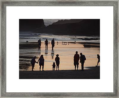 Silhouettes On The Beach Framed Print