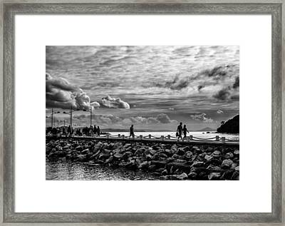 Silhouettes On The Jetty Framed Print