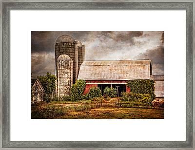 Silos And Barns Framed Print by Debra and Dave Vanderlaan