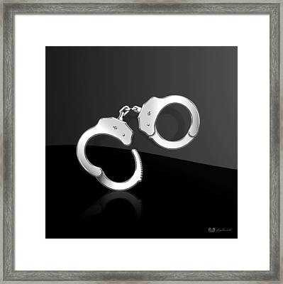 Silver Handcuffs On Black Background Framed Print by Serge Averbukh