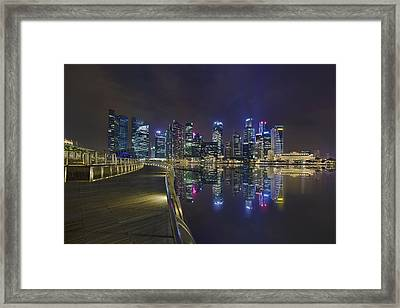 Singapore City Skyline Along Marina Bay Boardwalk At Night Framed Print by David Gn