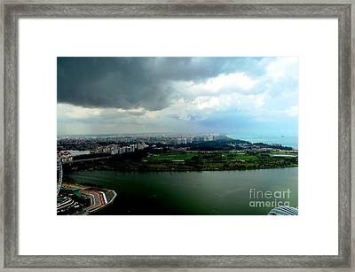 Singapore Storm Framed Print by Greg Cross