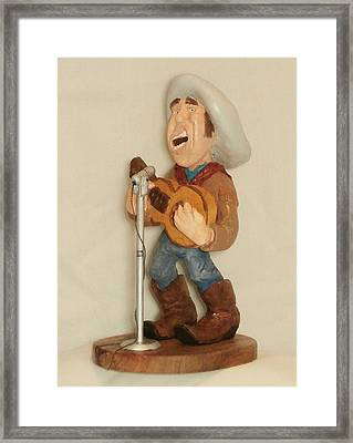 Singing Cowboy Framed Print by Russell Ellingsworth
