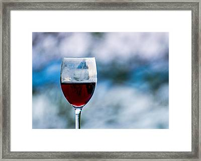 Single Glass Of Red Wine On Blue And White Background Framed Print by Photographic Arts And Design Studio