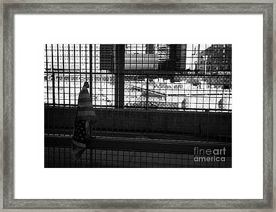 Single Small Memorial Us Flag Tied To The Fence At The World Trade Center Reconstruction Site  Framed Print by Joe Fox