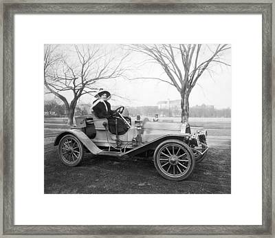 Single Woman In Auto Framed Print
