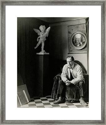 Sir William Orpen With A Cupid Statue Framed Print