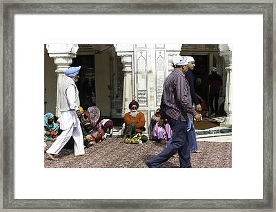 Sitting Devotees Inside The Golden Temple In Amritsar Framed Print by Ashish Agarwal