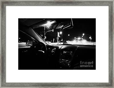 sitting in traffic at intersection on frozen city road at night Saskatoon Saskatchewan Canada Framed Print by Joe Fox