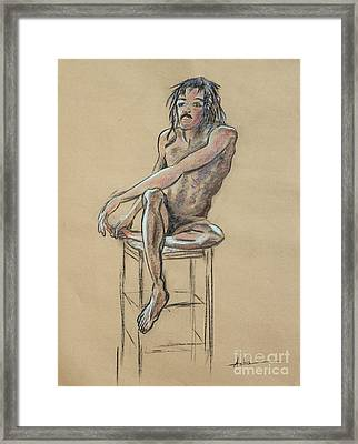 Sitting Man Holding His Foot Framed Print by Asha Carolyn Young