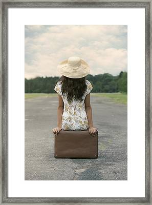 Sitting On A Suitcase Framed Print