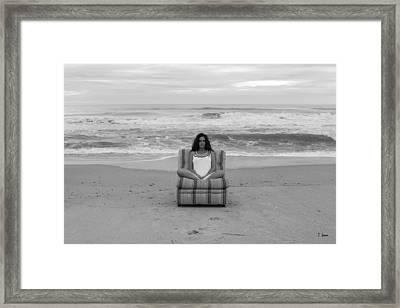 Sittinng On The Beach Framed Print by Thomas Leon