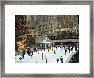 Framed Print featuring the photograph Skating In Rockefeller Center by Judith Morris