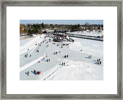 Skating On Dow's Lake At Bronson Bridge Framed Print by Rob Huntley