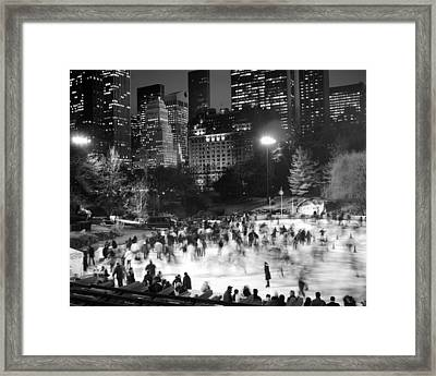 Framed Print featuring the photograph New York City - Skating Rink - Monochrome by Dave Beckerman