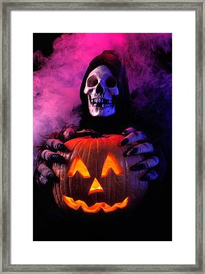 Skeleton Holding Pumpkin  Framed Print