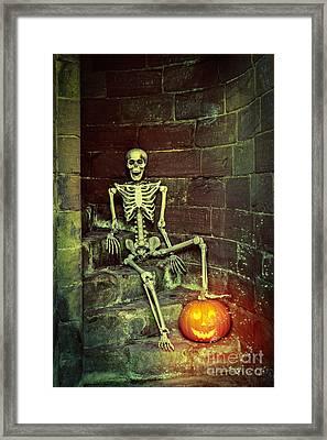 Skeleton On The Steps Framed Print by Amanda Elwell