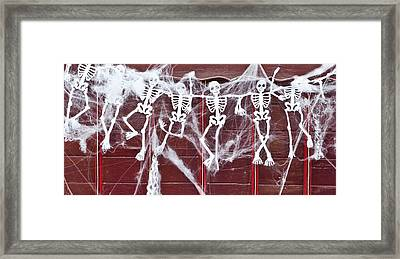 Skeletons Framed Print by Tom Gowanlock